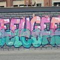 Eines der Graffitis an der Oesterholzstraße in Dortmund. Motiv: Refugees Welcome.